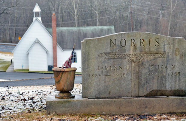 The church has grown over the years and been modernized. The hill behind it is full of graves. Most of the graves say Norris or Dorsey.
